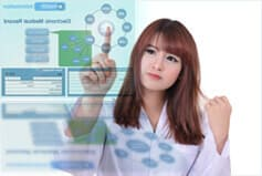 Doctor using electronic health record system (EHR) to search medical record of patient.